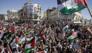 Palestinians wave flags and chant slogans during a rally calling for a reconciliation between the rival Palestinian leading factions Hamas in Gaza and Fatah in the West Bank, March 15, 2011.  Photo by: AP